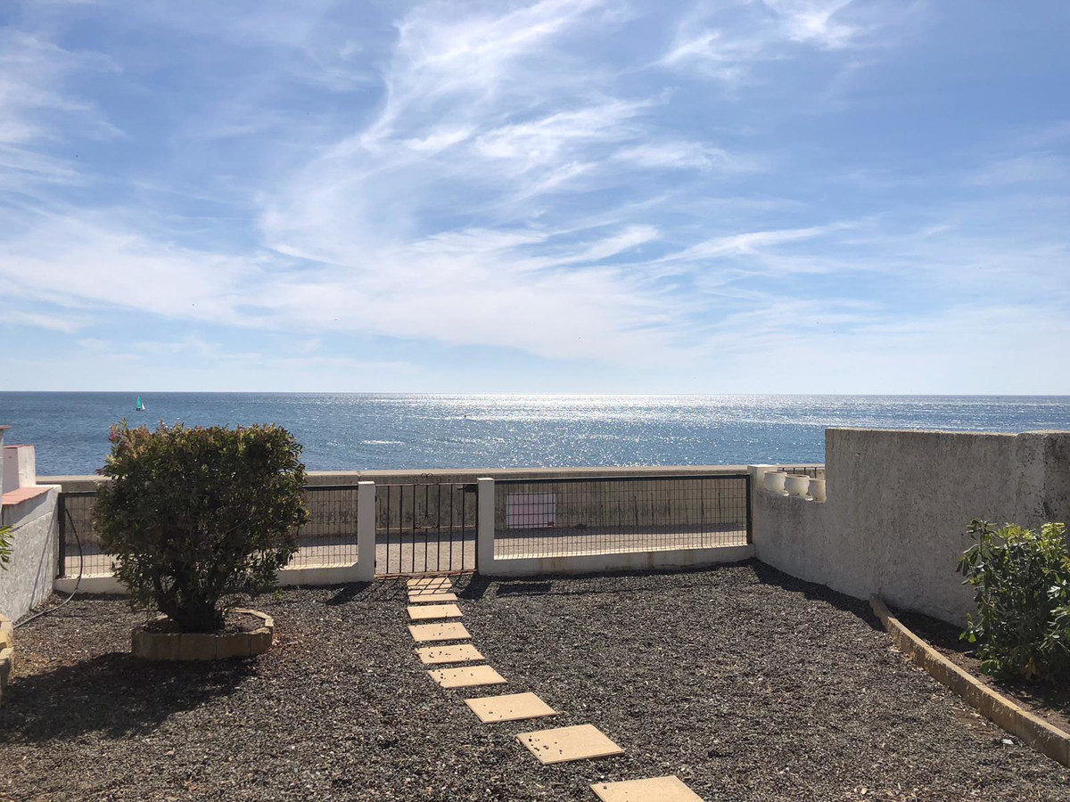 COZY SEMI-DETACHED HOUSE FIRST LINE BEACH FRONT WITH BIG TERRACES. Located in a really nice urbaniza,Spain