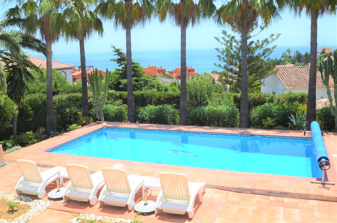 Detached villa with stunning sea views and beautiful garden on 2 plots with legal possibility to bui,Spain