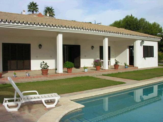 Bungalow styled villa, elevated position on relatively flat plot, which offers excellent sea, golf a,Spain