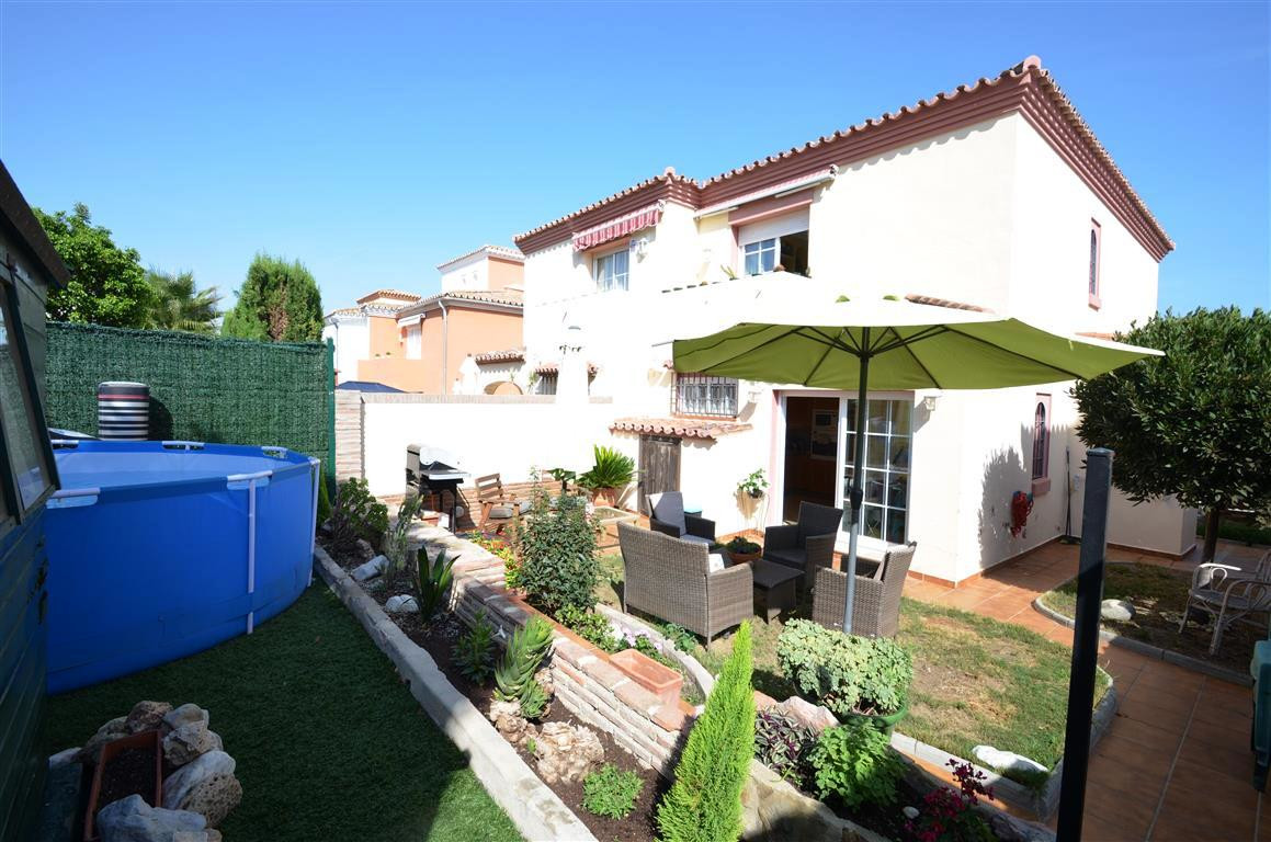 Confortable townhouse located in a quiet urbanization with mature gardens only 600mts. from the beac, Spain