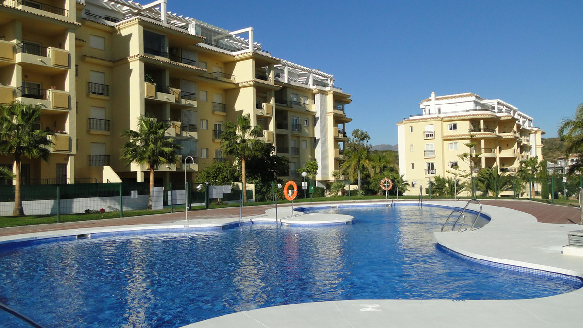 SUPERB GARDEN APARTMENT LOCATED JUST A SHORT WALK TO LA CALA, THE BEACH, A WIDE RANGE OF AMENITIES A,Spain