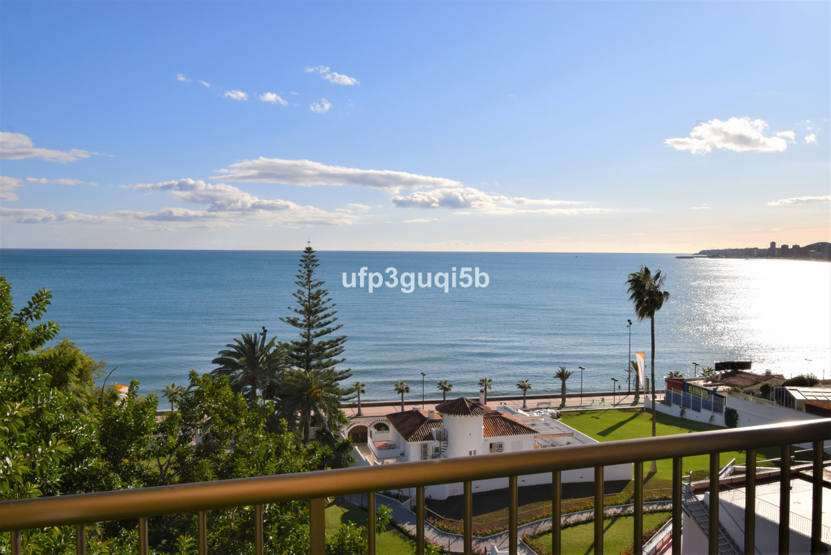 Fully renovated 2-bedroom apartment with sea view and large pool area by the sea in Fuengirola, Torr, Spain