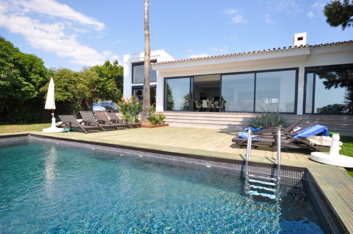 Beachfront villa recently finished construction in a contemporary style. Stunning sea, Gibraltar and,Spain