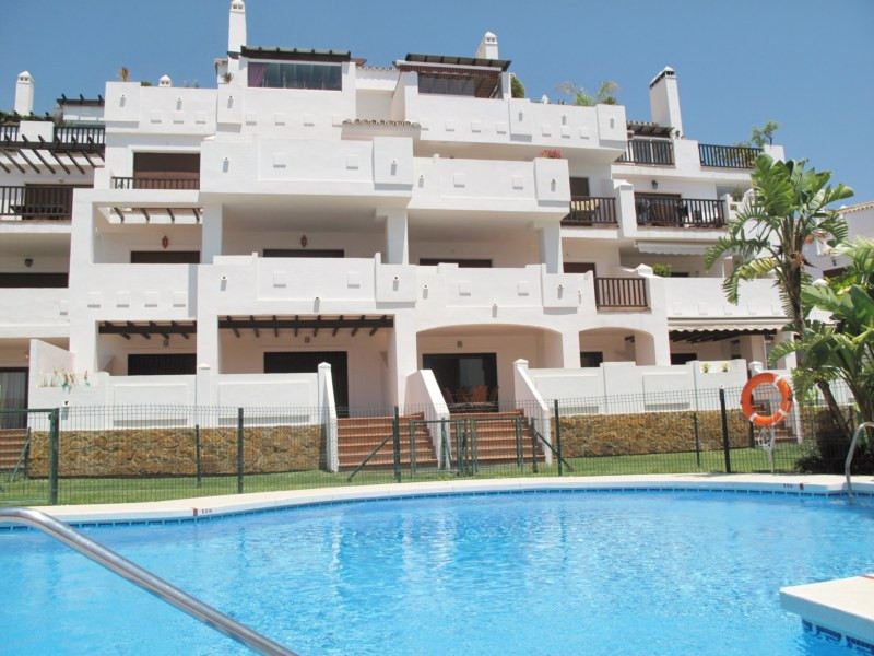 Ground floor Apartment with private garden.  This property is located in Finca San Antonio, a luxury, Spain