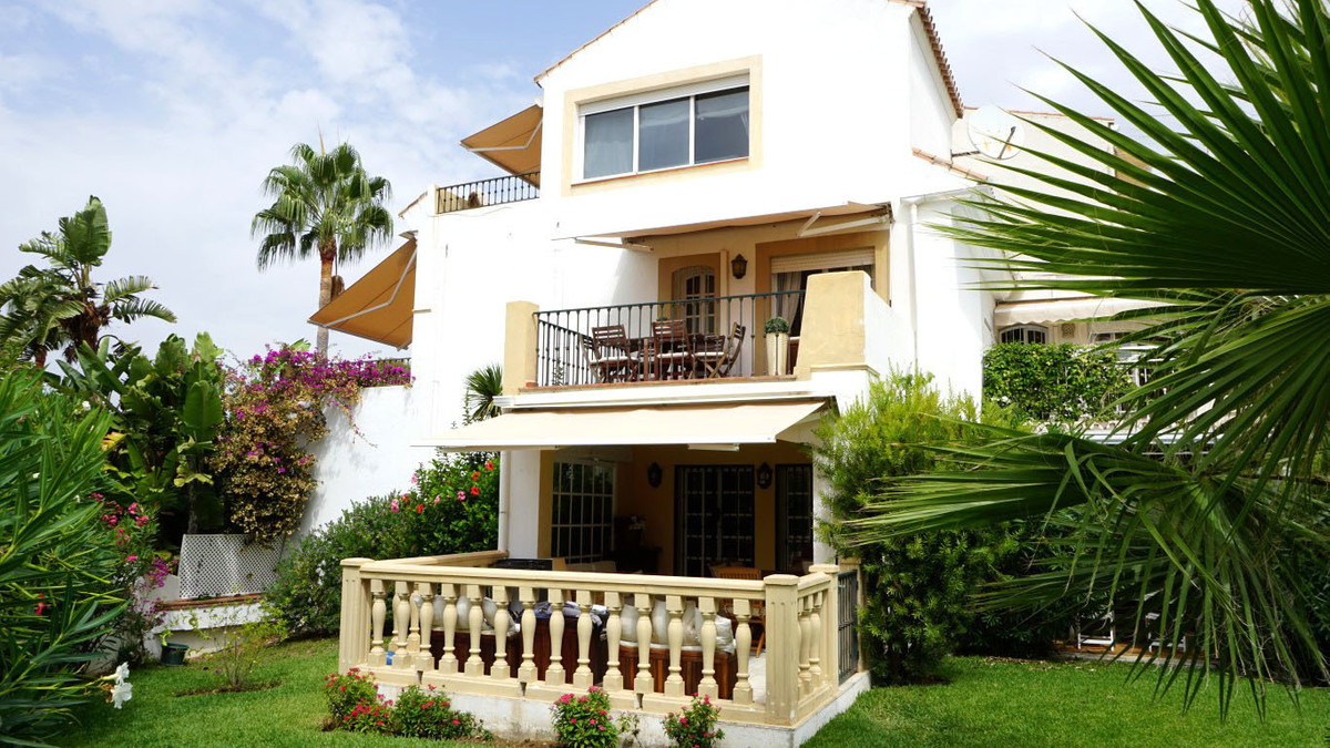 A three story townhouse situated in the popular Monte Biarritz location, within walking distance of ,Spain