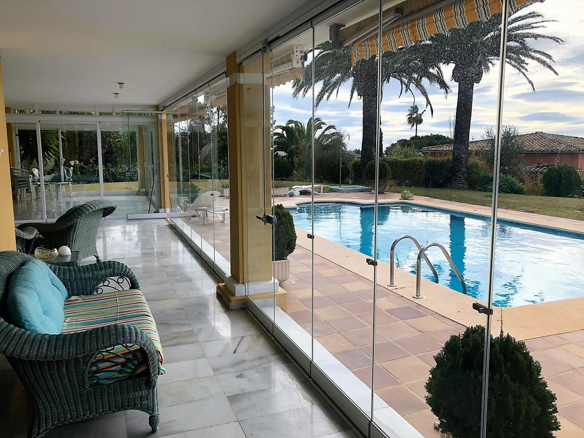 Beautiful and very spacious villa in Elviria with lovely garden and swimming pool. This property has,Spain