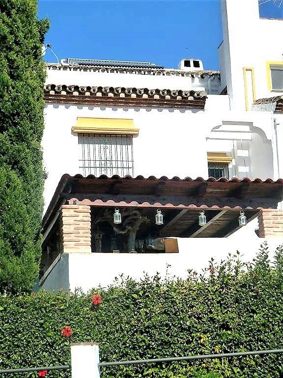 Beautiful corner townhouse located in quiet urbanisation with communal pool and lovely mature garden,Spain