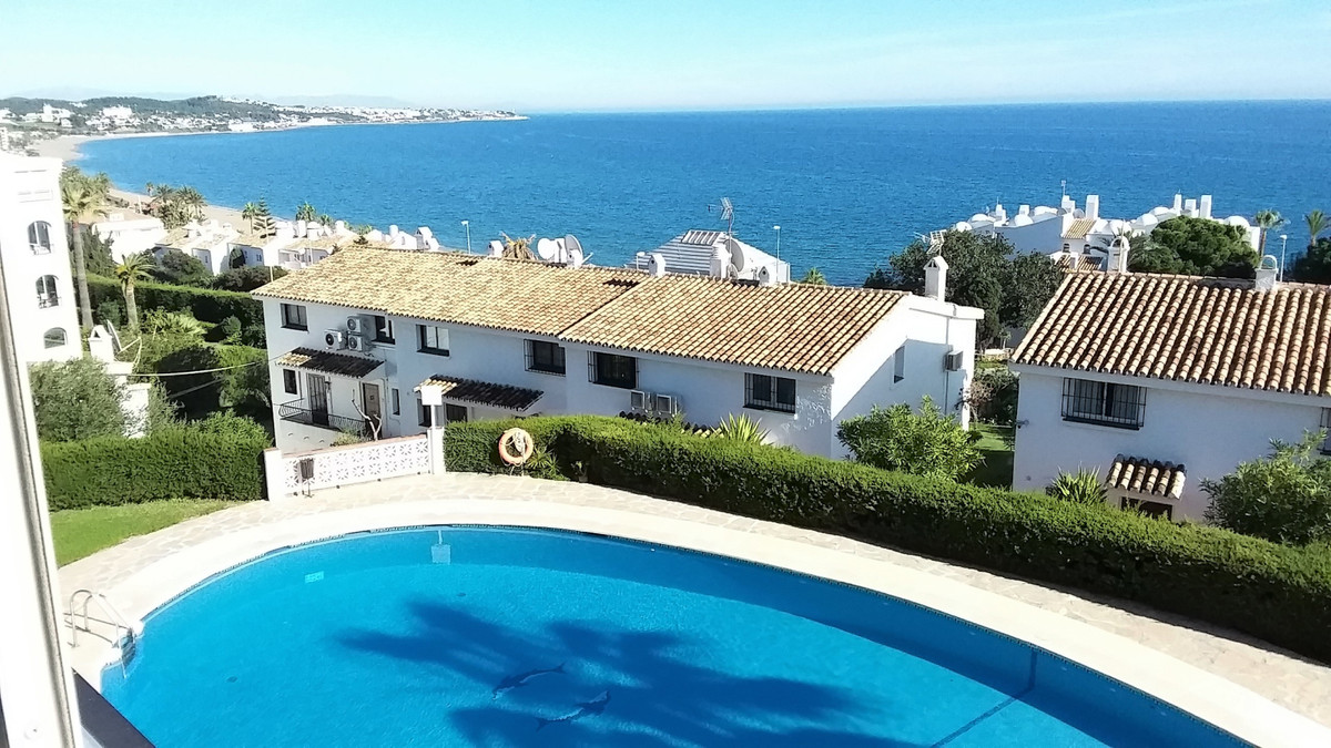 Lovely first floor apartment on the beach side in Riviera del Sol. It has sea views and is within fi, Spain