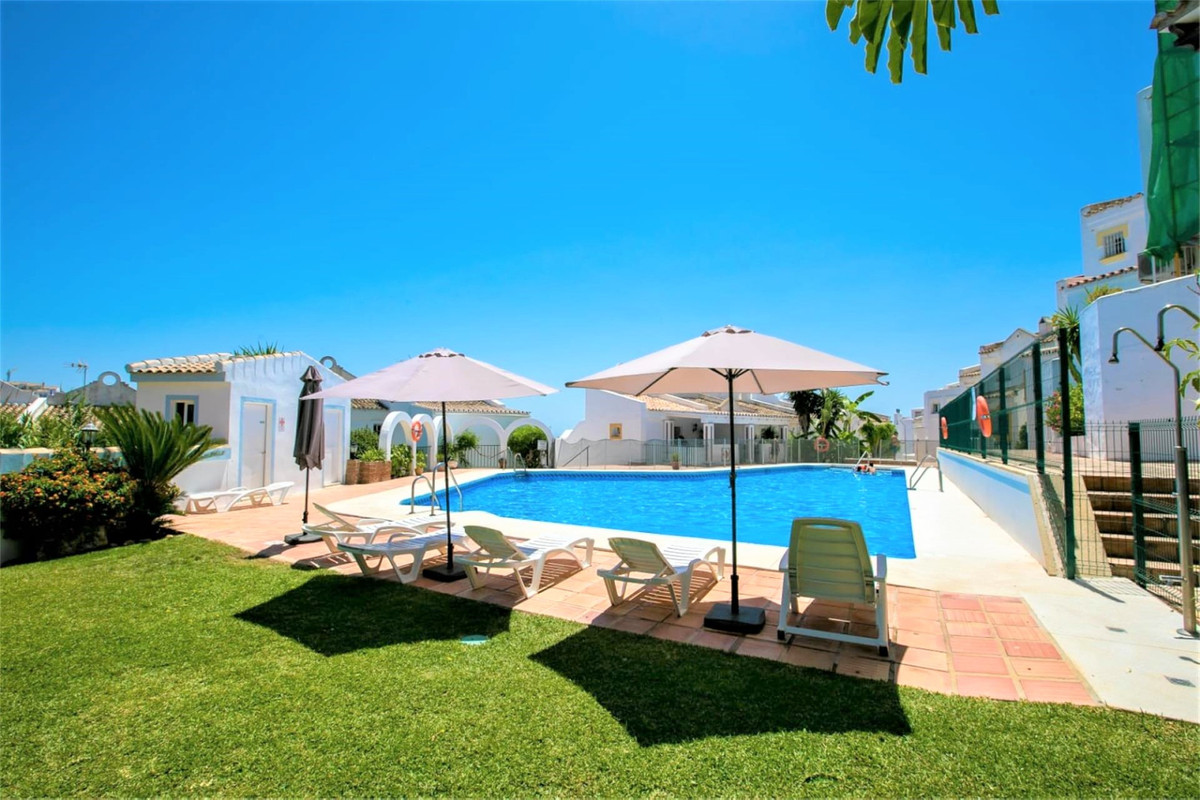 FANTASTIC FULLY REFORMED END TOWNHOUSE SITUATED BETWEEN THE SEA AND GOLF IN RESERVA DE MARBELLA.  Lo,Spain