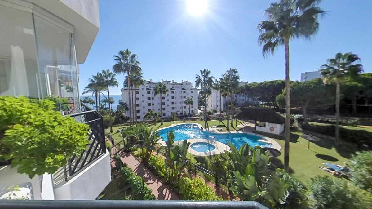 This is a 2 bedroom 2 bathroom west-facing second floor beachside apartment located in the popular b, Spain