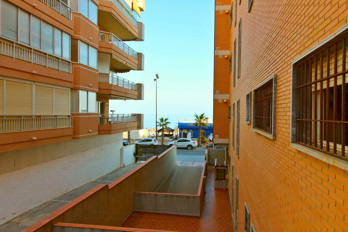 Frontline beach apartment with a terrace that circles the facade. It has an equipped kitchen and bat, Spain