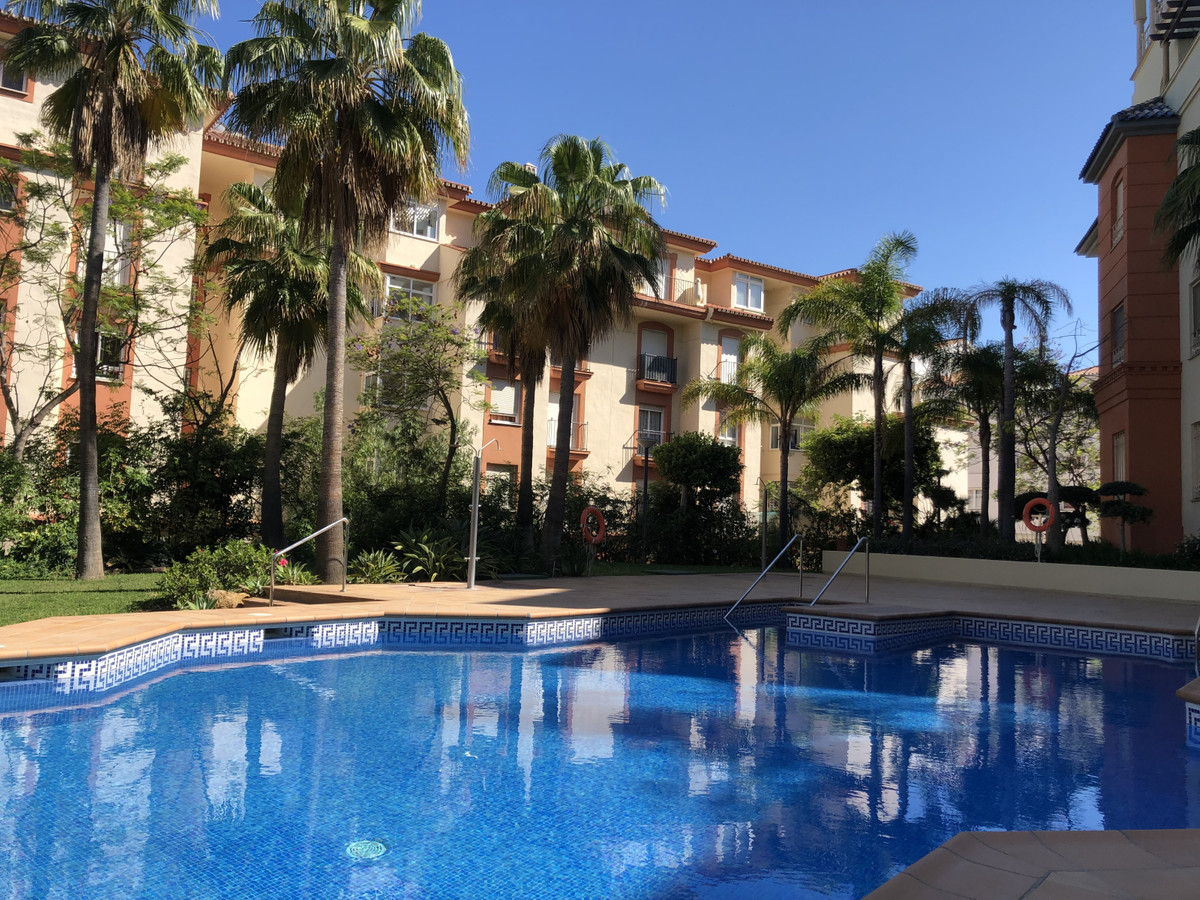 Spacious 2 bedroom apartment with terrace in urbanization with gardens, pool and security. Apartment,Spain