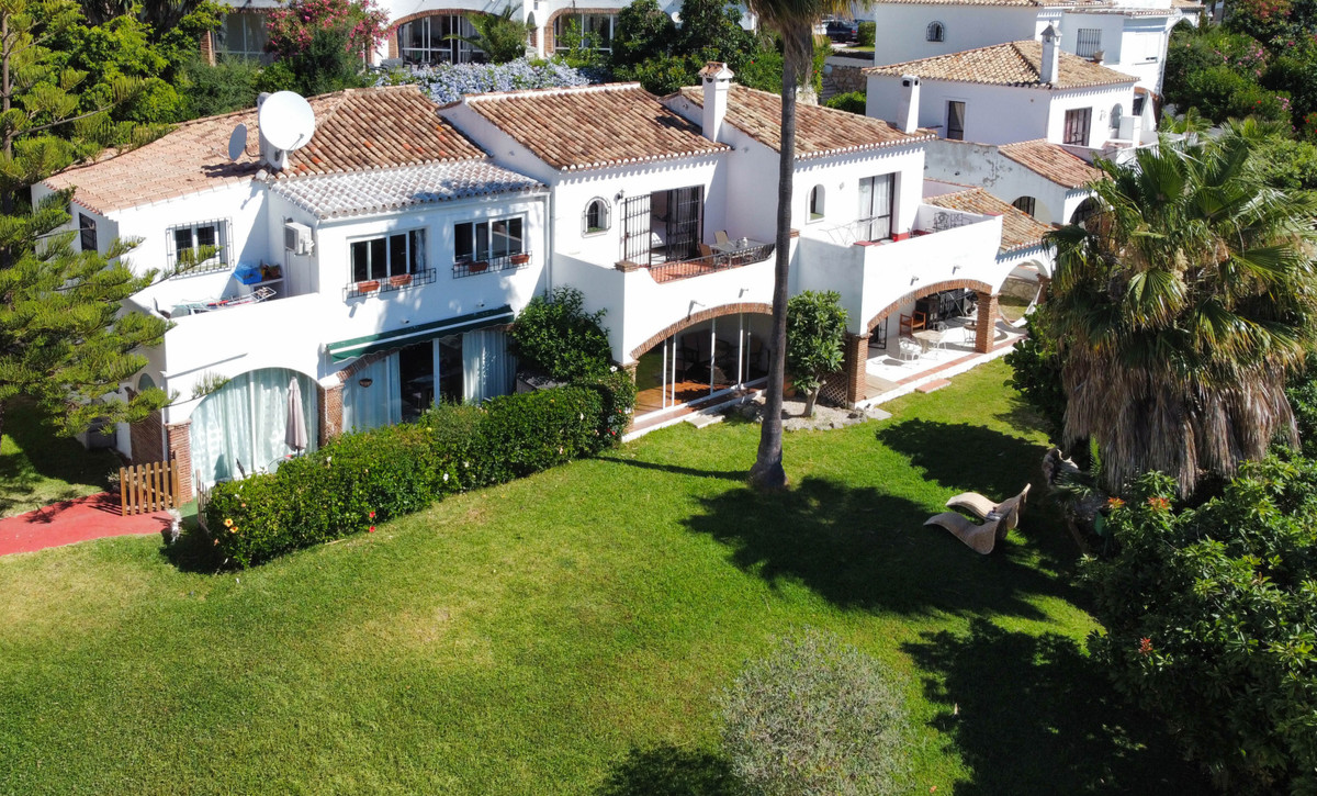 Beautiful townhouse located within a sought after community in Calahonda, offering stunning sea and ,Spain