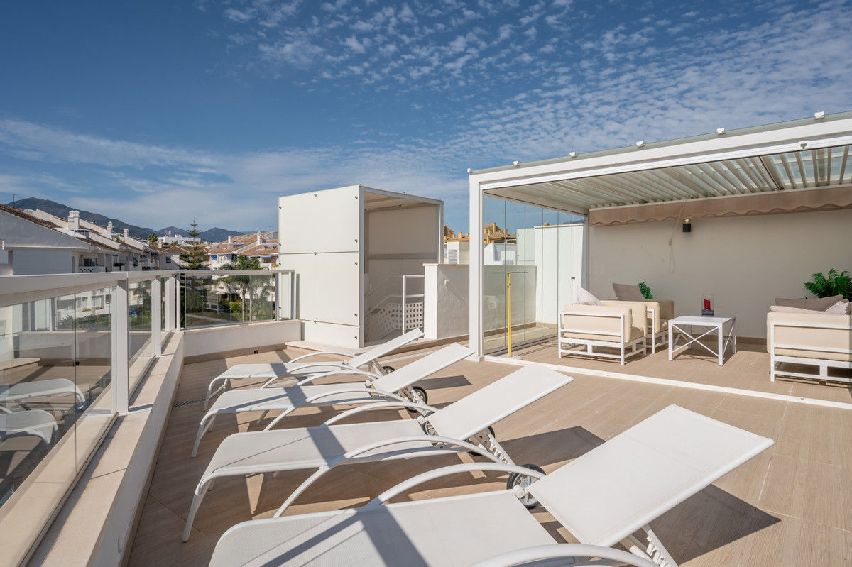 Enjoy living in this chic apartment with an expansive roof deck and within close proximity to San Pe, Spain