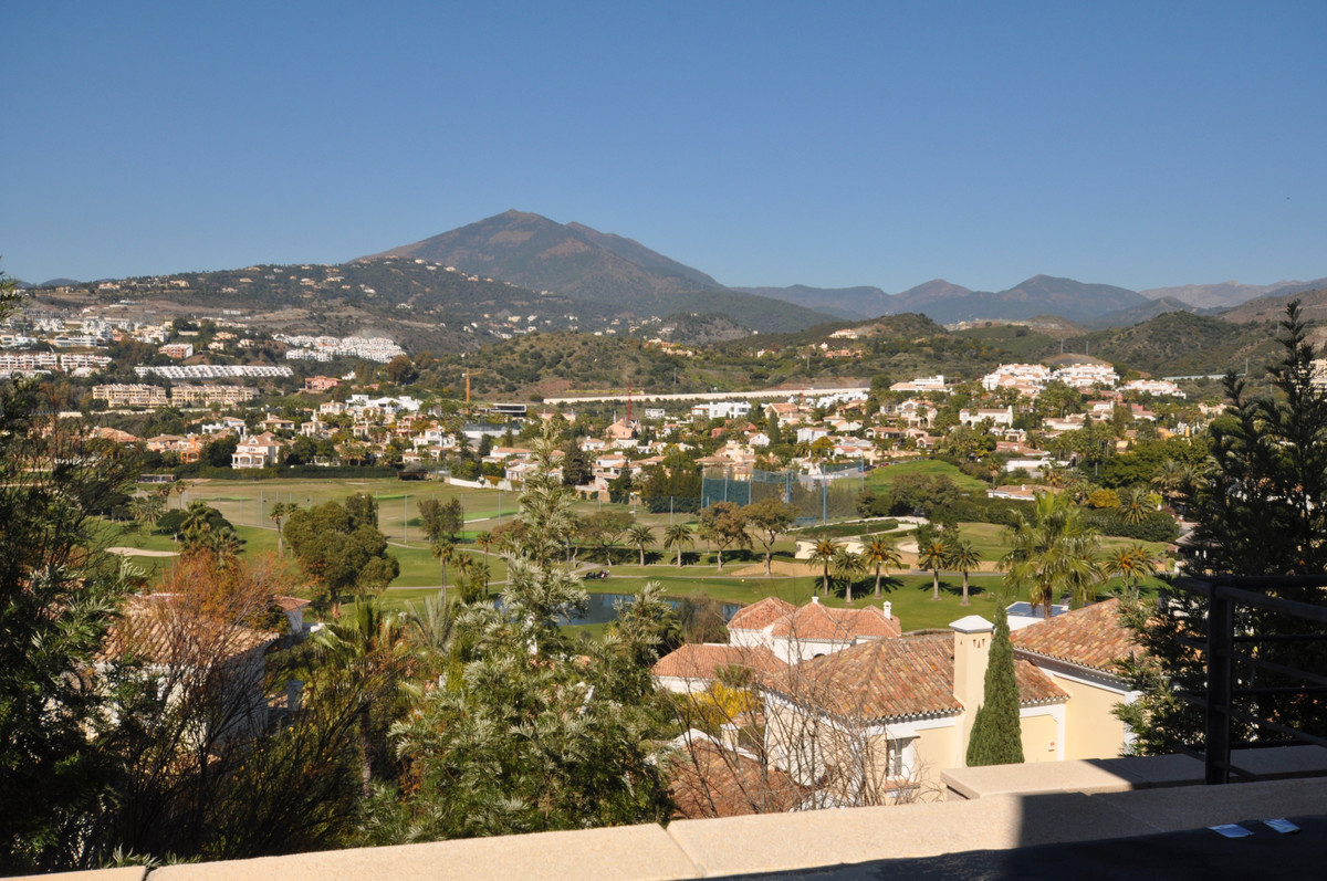 This smart 2-bedroom apartment strategically occupies a corner position and enjoys sweeping mountain, Spain