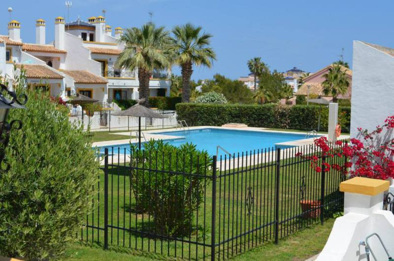 2 BEDROOM BUNGALOW WITH PRIVATE GARDEN IN  VILLAMARTIN, ORIHUELA COSTA. This corner property is sout,Spain