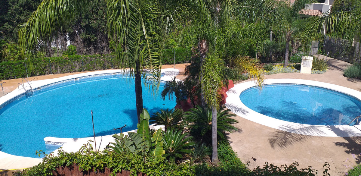 A spacious 3 bedroom first floor apartment with a large west facing terrace overlooking the communal,Spain