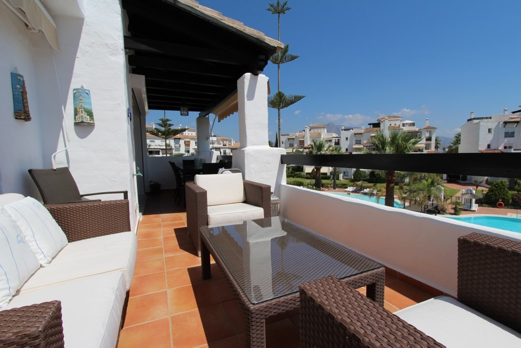 Immaculate south-east facing corner apartment with views over the gardens and swimming pool towards , Spain