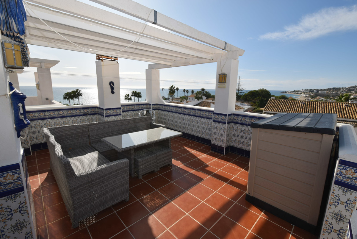 A beautifully presented 3 bedroom townhouse with fantastic sea views from its 4 terraces and located, Spain