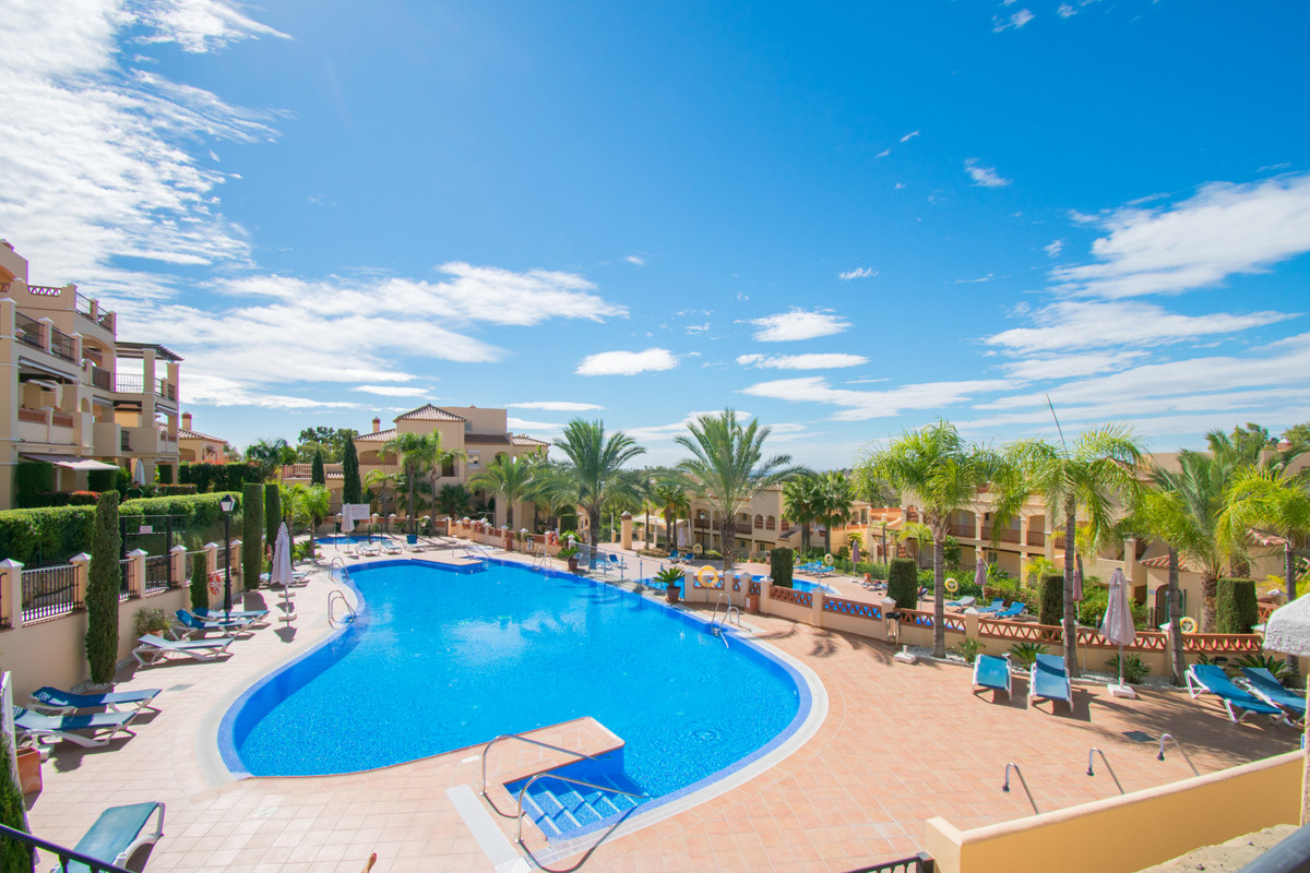 In a lovely sought-after development next to Atalaya Golf Course we have this very large, bright and,Spain
