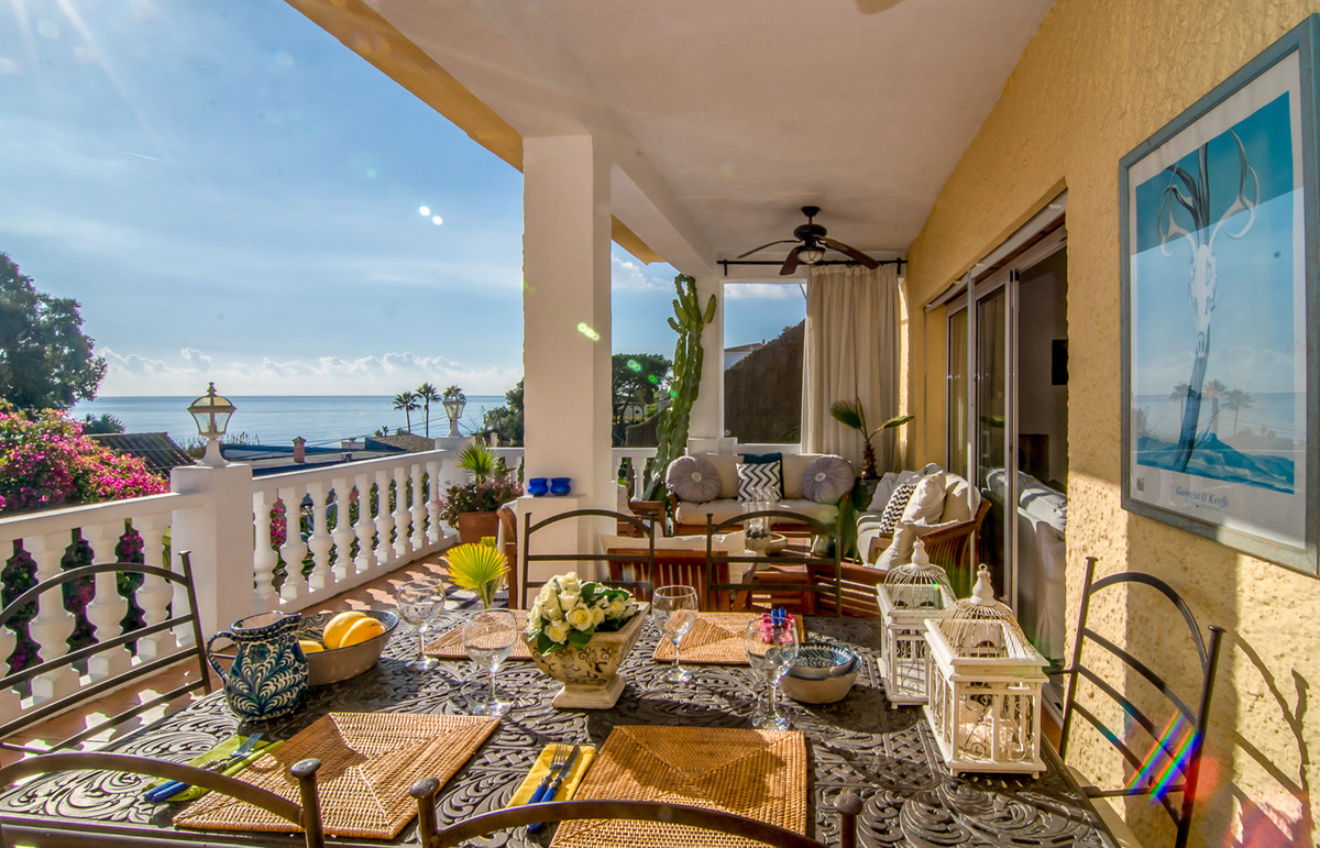 This charming beachside detached-villa with sea views has two separate accommodations with a total o,Spain