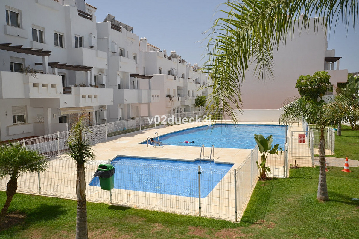 Modern nice apartment with south facing terrace and sea views. Nice communal pool and walking distan, Spain
