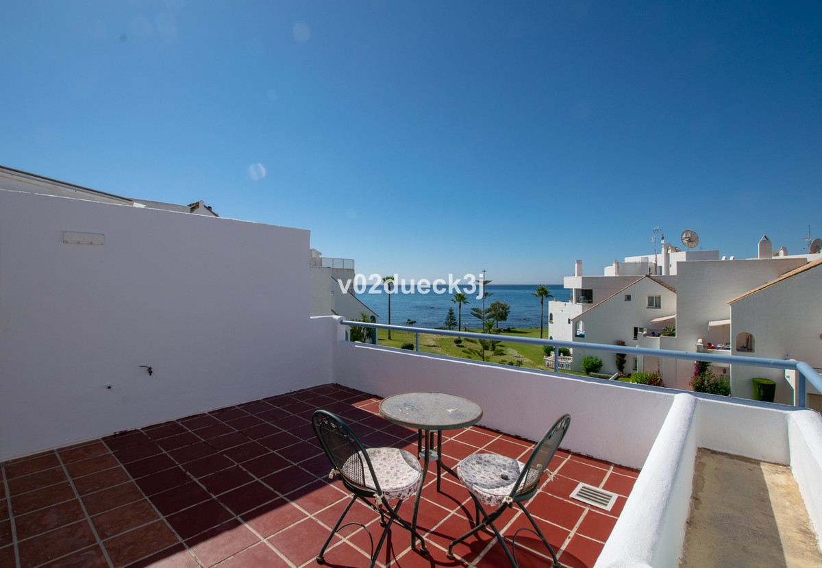 A wonderful townhouse with four bedrooms and three large terraces with lovely sea views from all, as, Spain